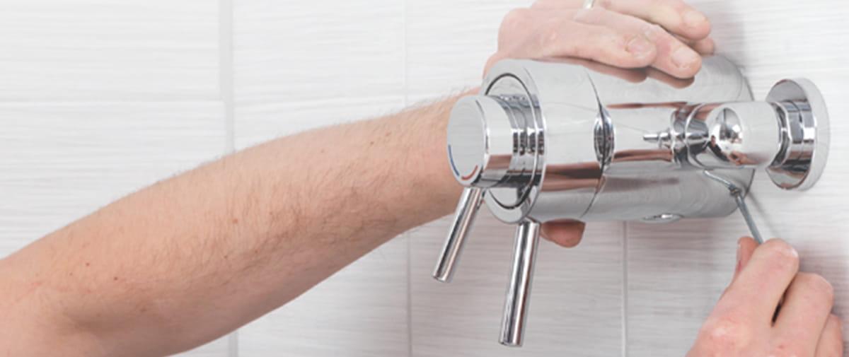Plumber installing mixer shower
