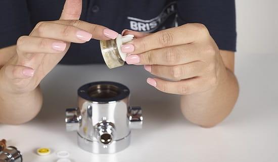 A Bristan shower valve having it's piston lubricated